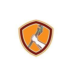 Hand holding adjustable wrench shield woodcut vector