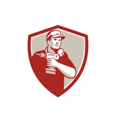 Handyman holding power drill crest retro vector
