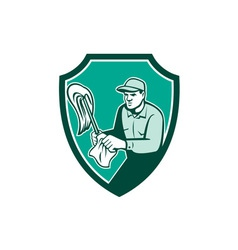 Janitor cleaner holding mop cloth shield retro vector