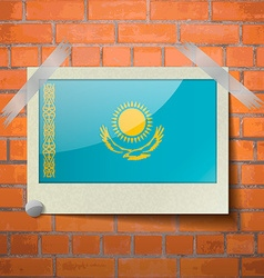 Flags kazakhstan scotch taped to a red brick wall vector