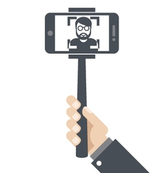 Hand with smartphone on selfie stick vector