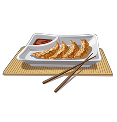 Chinese dumplings with sauce vector