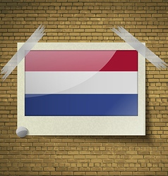 Flags netherlandsat frame on a brick background vector