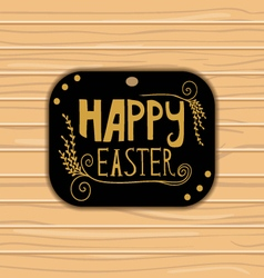 Golden happy easter lettering on wooden background vector