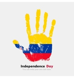 Handprint with the flag of colombia in grunge vector