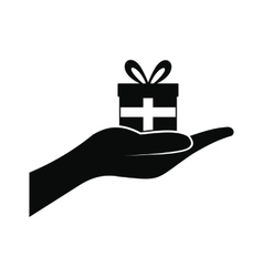 Small gift box in a hand icon vector image