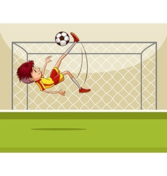 Boy kicking ball in the field vector