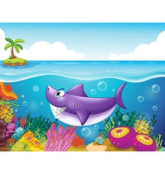 A smiling shark under the sea with corals vector image vector image