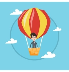 Man flying in hot air balloon vector