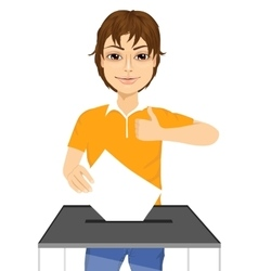 Young man putting ballot in vote box vector