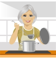 Mature woman with ladle cooking soup in pan vector