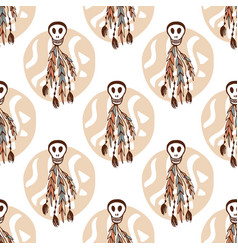 Ethnic seamless pattern with skulls and boho vector