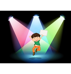 A young boy at the stage holding an empty paper vector image vector image