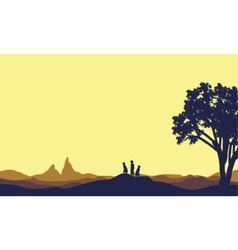 Meerkat at afternoon landscape silhouette vector