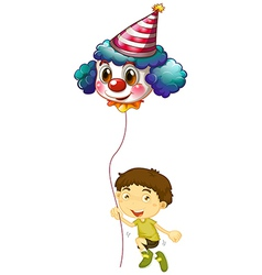 A young boy holding a clown balloon vector image