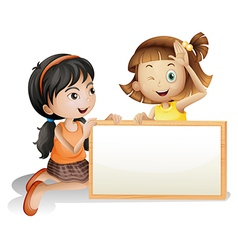 Two girls with a blank white board vector image vector image