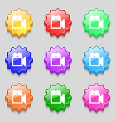 Camcorder icon sign symbol on nine wavy colourful vector