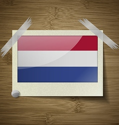 Flags netherlands at frame on wooden texture vector