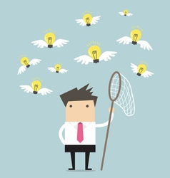 Businessman trying to catch a light bulb idea vector image vector image