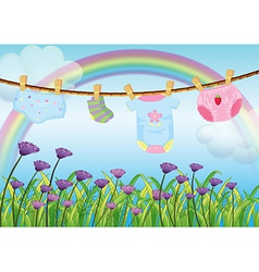 A childs clothes hanging above the garden vector