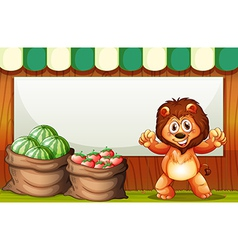 A happy lion selling fruits with an empty template vector