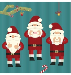 Three figures of santa clauses vector