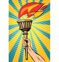 Torch with fire in the hand vector