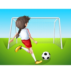 A girl practicing soccer vector