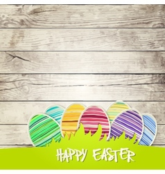 Easter eggs on wooden background vector image