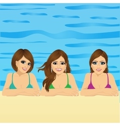Three young women in swimming pool vector