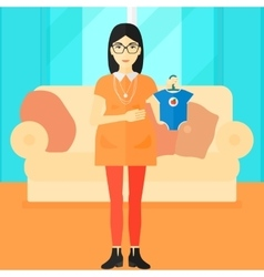 Pregnant woman with clothes for baby vector