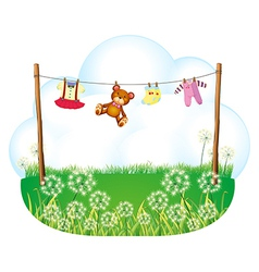 Baby things hanging above the weeds vector