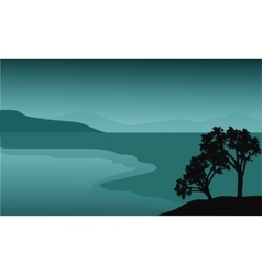 Silhouette of tree in the beach vector