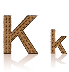Letter k is made grains of coffee isolated on whit vector