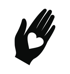 Heart in a hand black simple icon vector