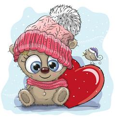 Cute cartoon teddy in a knitted cap vector