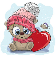 Cute cartoon teddy in a knitted cap vector