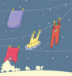 Washed clothes hanging under a snowy season vector