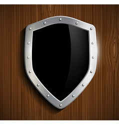Metal shield on a wooden surface vector