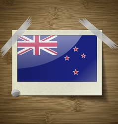 Flags new zeland at frame on wooden texture vector