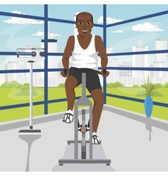 African american man doing exercise on bike at gym vector
