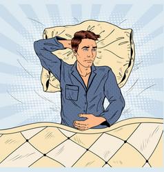 pop art man in bed suffering insomnia vector image