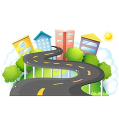 A curve road going to the city with high buildings vector image