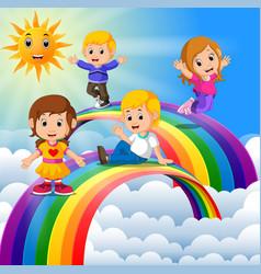 happy kids standing over the rainbow vector image vector image