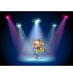 A clown dancing above the ball with spotlights vector