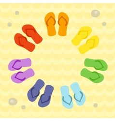 Rainbow flip flops in circle on the sand vector image