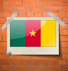 Flags cameroon scotch taped to a red brick wall vector image