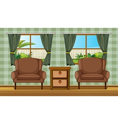 Cushion chairs and side table vector