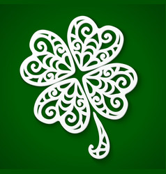 Ornate white cut out paper clover vector