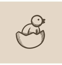 Chick peeking out of egg shell sketch icon vector
